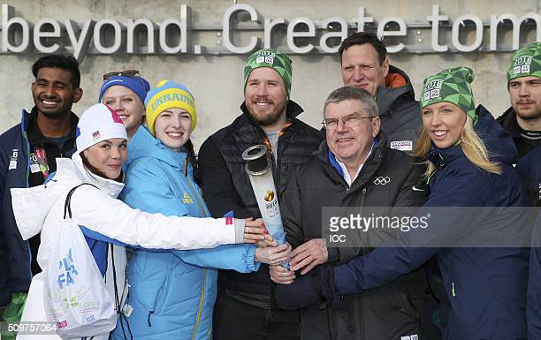 In this handout image supplied by the IOC Thomas Bach President of the International Olympic Committee poses with the torch of the Lillehammer 2016...