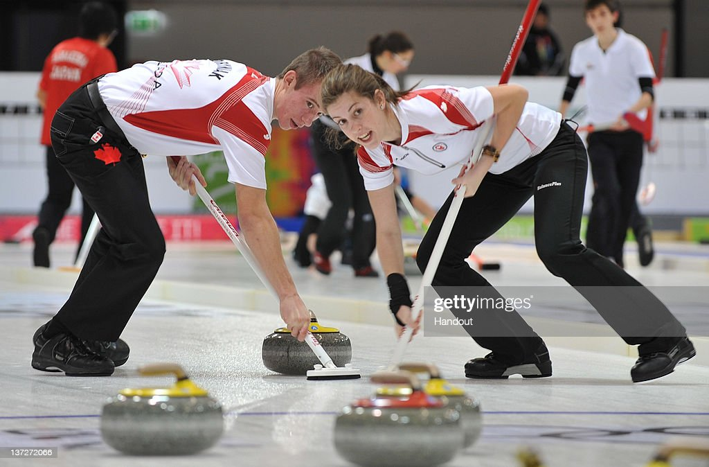 In this handout image supplied by the IOC (International Olympic Committee), Thomas Scoffin (L) and Emily Gray of Canada compete in the Curling Mixed Team Round Robin Red Group Session at the Innsbruck Exhibition Centre during the Innsbruck 2012 Winter Youth Olympic Games, on January 14, 2012 in Innsbruck, Austria.