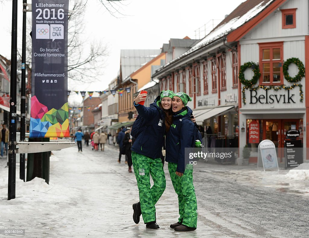 In this handout image supplied by the IOC visitors pose for a photo in the town centre of Lillehammer as dusk falls with three days to go before the 2016 Winter Youth Olympic Games on February 9, 2016 in Lillehammer, Norway.