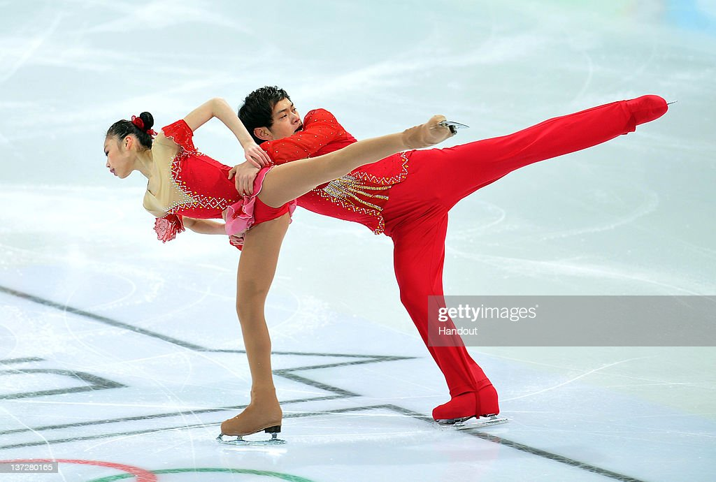 In this handout image supplied by the IOC (International Olympic Committee), Xiaoyu Yu and Yang Jin of China perform their short program in the figure skating at Olympiaworl during the Innsbruck 2012 Winter Youth Olympic Games, on January 14, 2012 in Innsbruck, Austria.