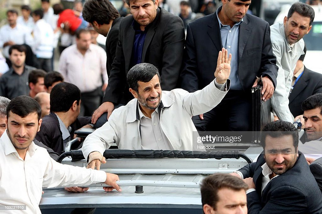 In this handout image supplied by the Iranian President's Office Iranian President Mahmoud Ahmadinejad waves to members of the public from his car in...