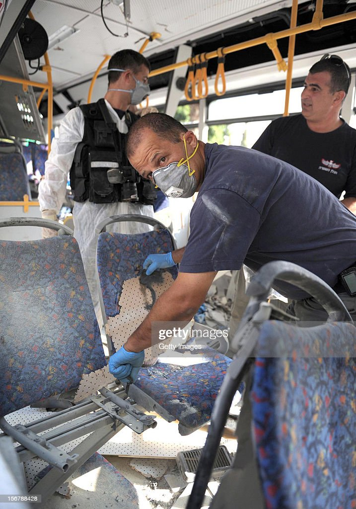 In this handout image supplied by the Israeli Government Press Office (GPO), emergency services attend the scene after a bus exploded with passengers onboard on November 21, 2012 in central Tel Aviv, Israel. At least ten people have been injured in a blast on a bus near military headquarters in what is being described as terrorist attack which threatens to derail ongoing cease-fire negotiations between Israeli and Palestinian authorities.