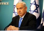 In this handout image supplied by the Israeli Government Press Office Prime Minister Benjamin Netanyahu delivers a speech at his office on November...