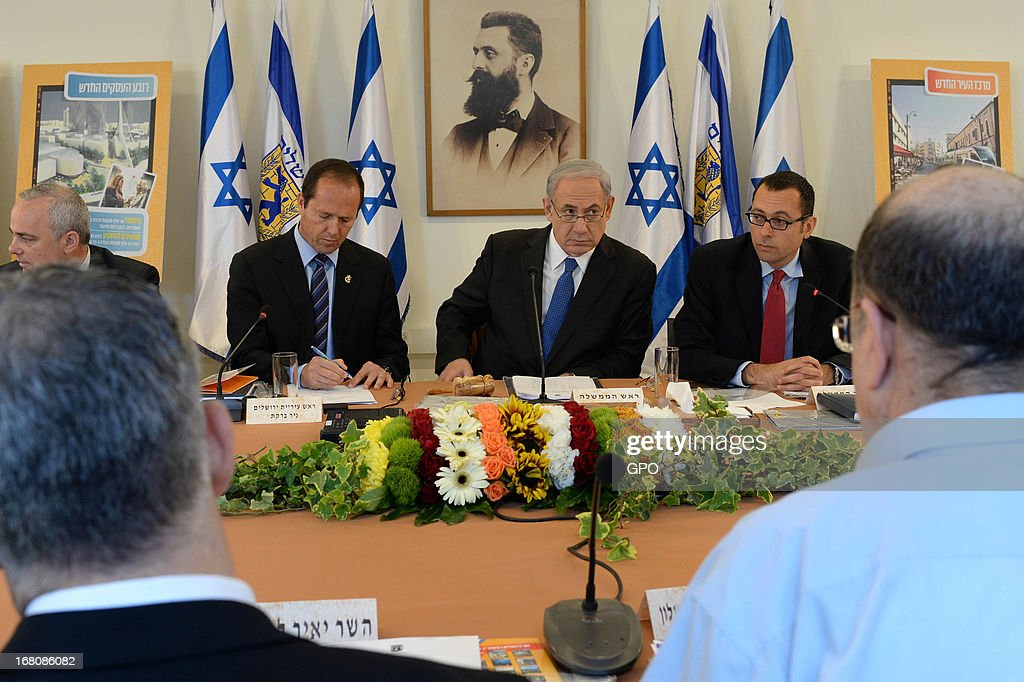 In this handout image supplied by the Israeli Government press office (GPO) Prime Minister <a gi-track='captionPersonalityLinkClicked' href=/galleries/search?phrase=Benjamin+Netanyahu&family=editorial&specificpeople=118594 ng-click='$event.stopPropagation()'>Benjamin Netanyahu</a> chairs a cabinet meeting at the Herzl Museum on May 5, 2013 in Jerusalem, Israel. Syria has accused Israel of launching rocket attacks on the Jamraya research centre in Damascus which, it is thought, is involved in the research of chemical weapons.