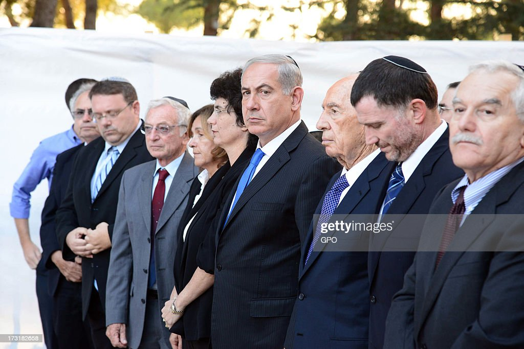 In this handout image supplied by the Israeli Government Press Office (GPO), Israeli President <a gi-track='captionPersonalityLinkClicked' href=/galleries/search?phrase=Shimon+Peres&family=editorial&specificpeople=201775 ng-click='$event.stopPropagation()'>Shimon Peres</a> (3R) and Prime Minister <a gi-track='captionPersonalityLinkClicked' href=/galleries/search?phrase=Benjamin+Netanyahu&family=editorial&specificpeople=118594 ng-click='$event.stopPropagation()'>Benjamin Netanyahu</a> (4R) attend a memorial ceremony for the late Yitzhak Shamir July 9, 2013 in Jerusalem, Israel. Shamir, a former prime minister of Israel, died June 30, 2012.