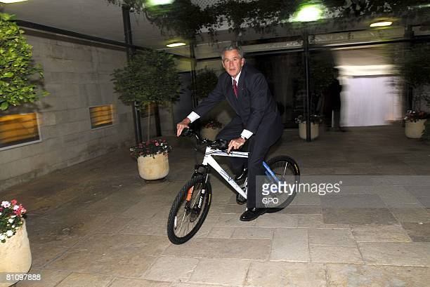 In this handout image supplied by the Israeli Government Press Office US President George W Bush rides an Israeli made bicycle presented to him by...