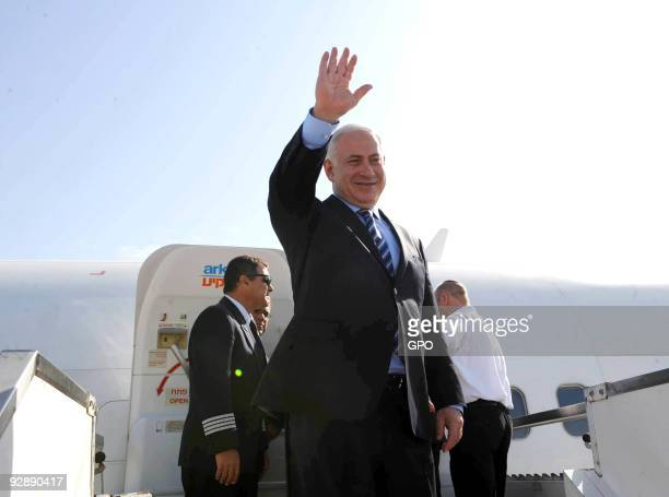 In this handout image supplied by the Israeli Government Press Office Israeli Prime Minister Benjamin Netanyahu boards a plane at Ben Gurion Airport...