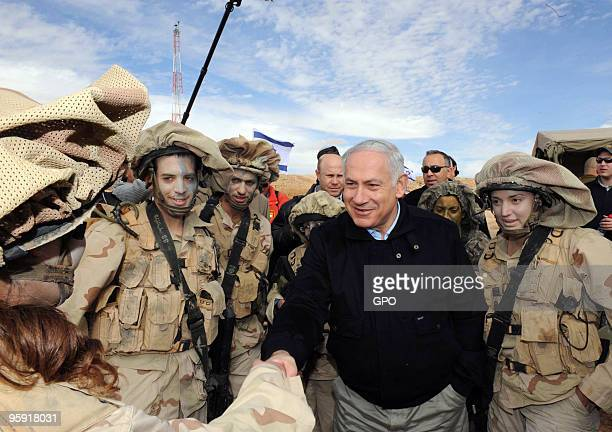 In this handout image supplied by the Israeli Government Press Office Israeli prime minister Benjamin Netanyahu greets Israeli Defense Force soldiers...