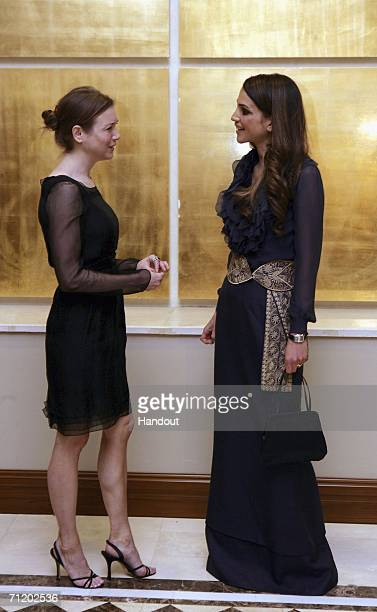 In this handout image supplied by the Jordanian Royal Court Queen Rania of Jordan and actress Renee Zellweger attend the opening session of the...