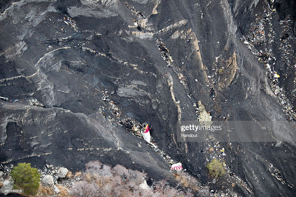In this handout image supplied by the Ministere de l'Interieur search and rescue teams attend to the crash site of the Germanwings Airbus in the...