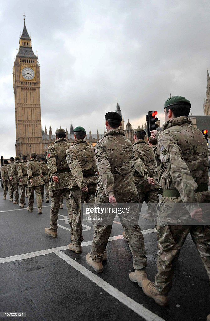 In this handout image supplied by the Ministry of Defence (MoD), around 120 soldiers parade from Wellington Barracks to the Palace of Westminster to mark the end of the 12th Mechanized's operational tour in Afghanistan, on November 26, 2012 in London, England. The soldiers served on Operation Herrick 16 as part of Task Force Helmand.