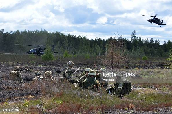 In this handout image supplied by the Ministry of Defence Soldiers take part in a military exercise in an undisclosed location on June 10 2015 in...