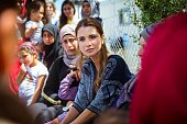 In this handout image supplied by the Office of Her Majesty Queen Rania Al Abdullah Royal Hashemite Court Queen Rania of Jordan meets Syrian refuges...