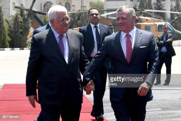 In this handout image supplied by the office of the Palestinian president King Abdullah II of Jordan is greeted by Palestinian President Mahmoud...