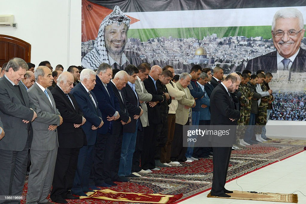In this handout image supplied by the office of the Palestinian president, Palestinian President Mahmoud Abbas (4L) attends Friday prayers on November 16, 2012 in Ramallah, West Bank. Abbas has reportedly reached out to Arab and Western leaders for aid in the face of the heightening conflict between Israel and Gaza.
