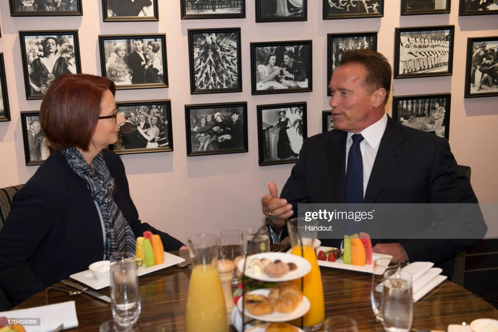 In this handout image supplied by the Office of the Prime Minister, <a gi-track='captionPersonalityLinkClicked' href=/galleries/search?phrase=Arnold+Schwarzenegger&family=editorial&specificpeople=156406 ng-click='$event.stopPropagation()'>Arnold Schwarzenegger</a> meets with Australian Prime Minister, <a gi-track='captionPersonalityLinkClicked' href=/galleries/search?phrase=Julia+Gillard&family=editorial&specificpeople=787281 ng-click='$event.stopPropagation()'>Julia Gillard</a>, on June 13, 2013 in Perth, Australia. Gillard and Schwarzenegger discussed climate change and the experience that the former Californian governor had when he put a price on carbon.