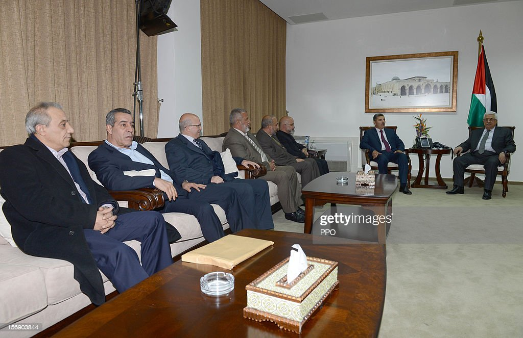 In this handout image supplied by the Palestinian President's Office (PPO), Palestinian President Mahmoud Abbas (R) meets with a delegation of the Hamas leadership on November 24, 2012 in Ramallah, West Bank. The meeting was held to discuss a reconciliation between Hamas and Fatah along with Abbas' bid for UN non-member observer state status that will be presented on November 29 to the UN General Assembly. A fatah delegation will visit the Gaza Strip on Sunday.