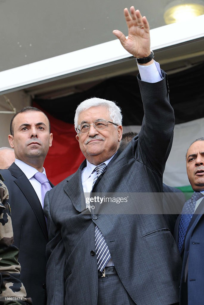 In this handout image supplied by the Palestinian President's Office (PPO), <a gi-track='captionPersonalityLinkClicked' href=/galleries/search?phrase=Mahmoud+Abbas&family=editorial&specificpeople=176534 ng-click='$event.stopPropagation()'>Mahmoud Abbas</a> meets crowds of supporters before heading to the United Nations on November 25, 2012 in Ramallah, West Bank. Abbas will make a bid for UN non-member observer state status on November 29 to the UN General Assembly.