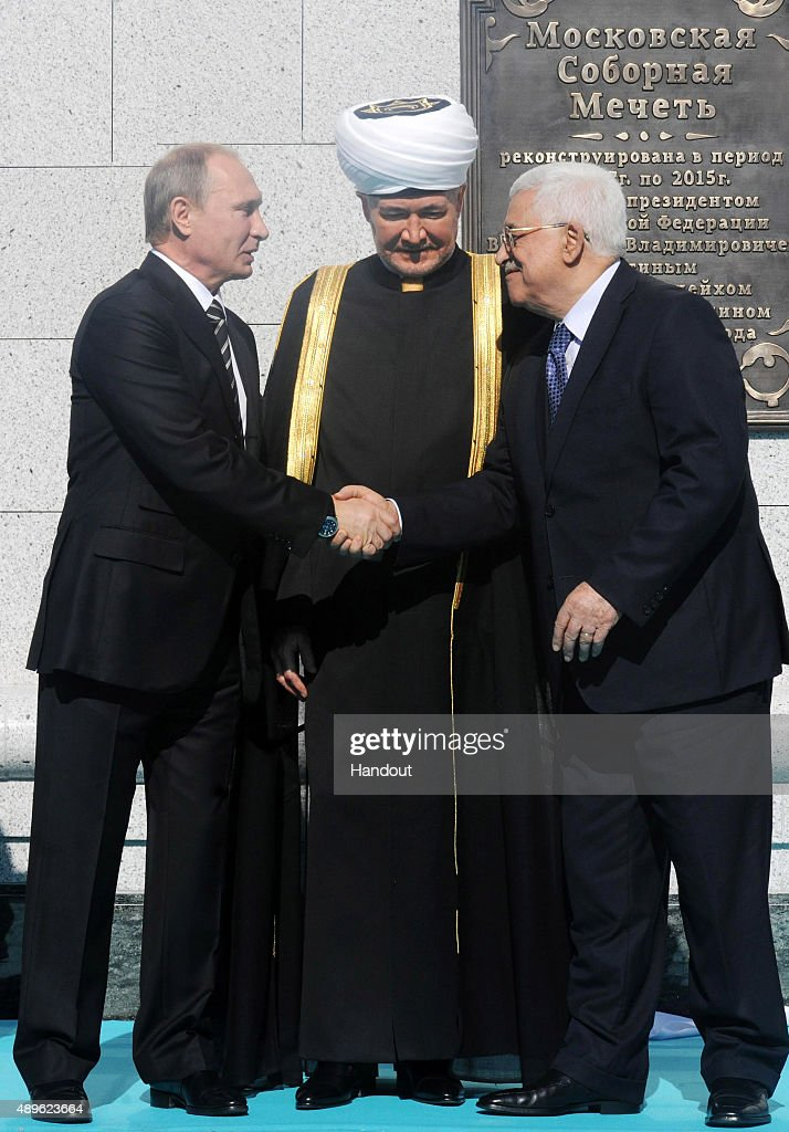 In this handout image supplied by the Palestinian President's Office (PPO), (L-R) Russian President Vladimir Putin, Russian Grand Mufti Ravil Gainutdin and Palestine's President Mahmoud Abbas attend an opening ceremony for the newly restored Moscow Cathedral Mosque on September 23, 2015 in Moscow, Russia.