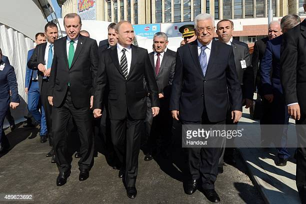 In this handout image supplied by the Palestinian President's Office Russian President Vladimir Putin Turkish President Tayyip Erdogan and...