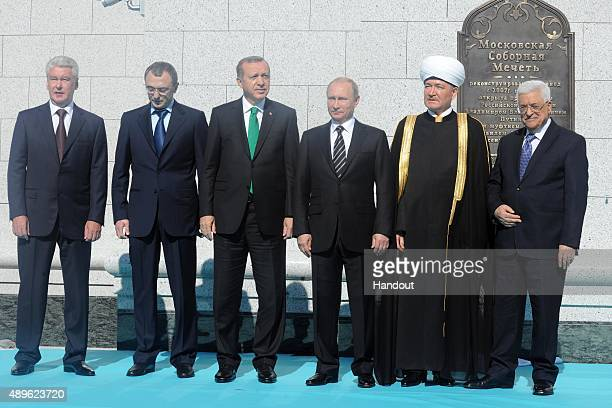 In this handout image supplied by the Palestinian President's Office Russian President Vladimir Putin Turkish President Tayyip Erdogan Russian...