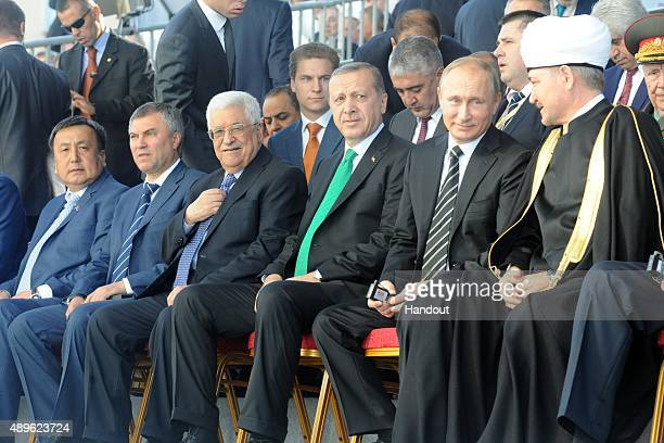 In this handout image supplied by the Palestinian President's Office Russian President Vladimir Putin Turkish President Tayyip Erdogan Palestine's...