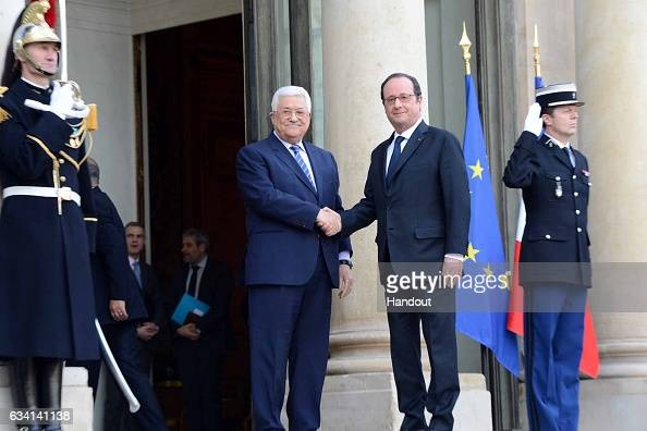 In this handout image supplied by the Palestinian President's Office President Mahmoud Abbas meets with President Francois Hollande of France on...
