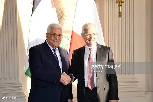 In this handout image supplied by the Palestinian President's Office President Mahmoud Abbas meets with Claude Bartolone President of the French...