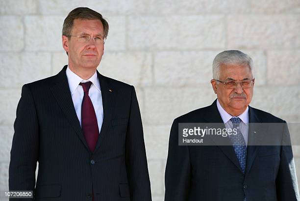 In this handout image supplied by the Palestinian Press Office President Mahmoud Abbas and German President Christian Wulff review a guard of honour...