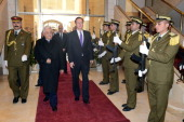 In this handout image supplied by the Palestinian Press Office Palestinian Authority President Mahmoud Abbas accompanies British Prime Minister David...
