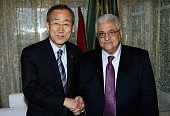 In this handout image supplied by the Palestinian Press Office Palestinian President Mahmoud Abbas greets UN Secretary General Ban KiMoon in Sirte on...