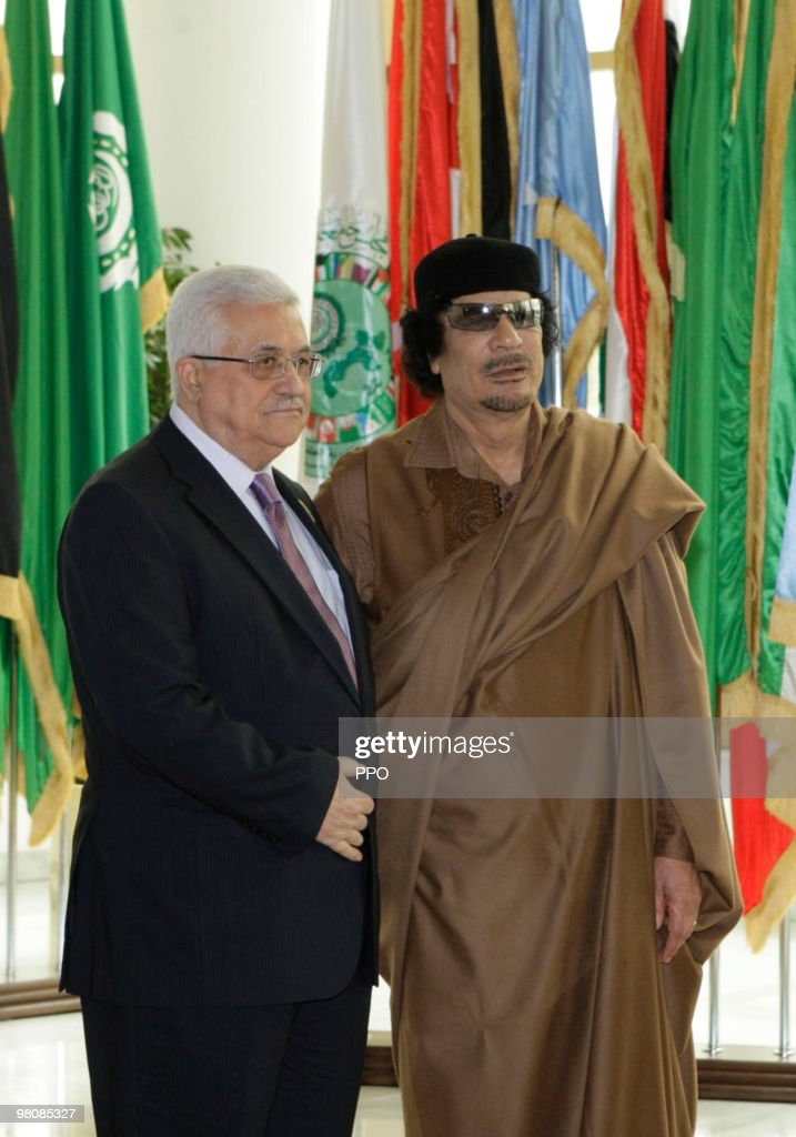 In this handout image supplied by the Palestinian Press Office (PPO), Palestinian President <a gi-track='captionPersonalityLinkClicked' href=/galleries/search?phrase=Mahmoud+Abbas&family=editorial&specificpeople=176534 ng-click='$event.stopPropagation()'>Mahmoud Abbas</a> greets Libyan leader <a gi-track='captionPersonalityLinkClicked' href=/galleries/search?phrase=Muammar+Gaddafi&family=editorial&specificpeople=202172 ng-click='$event.stopPropagation()'>Muammar Gaddafi</a> on the first day of the Arab Summit in Sirte on March 27, 2010 in Libya. Abbas arrived in Libya on Friday to participate in the 22nd Arab summit which will last until Sunday.