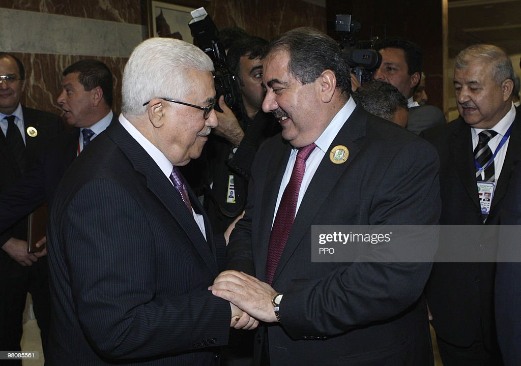 In this handout image supplied by the Palestinian Press Office (PPO), Palestinian President <a gi-track='captionPersonalityLinkClicked' href=/galleries/search?phrase=Mahmoud+Abbas&family=editorial&specificpeople=176534 ng-click='$event.stopPropagation()'>Mahmoud Abbas</a> talking to Iraqi Foreign Minister <a gi-track='captionPersonalityLinkClicked' href=/galleries/search?phrase=Hoshyar+Zebari&family=editorial&specificpeople=227333 ng-click='$event.stopPropagation()'>Hoshyar Zebari</a> on the first day of the Arab Summit in Sirte on March 27, 2010 in Libya. Abbas arrived in Libya on Friday to participate in the 22nd Arab summit which will last until Sunday.