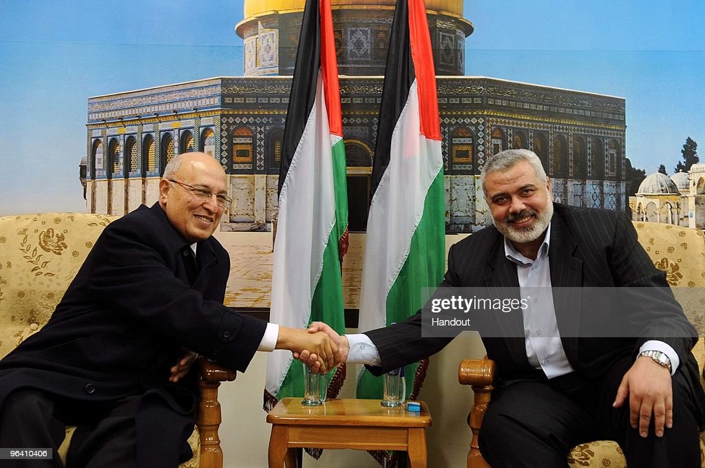 In this handout image supplied by the PPM, Hamas leader in Gaza Ismail Haniyeh receives Fatah Central Committee member Nabil Sha'ath on February 4, 2010 in Ash-Shati Refugee Camp, Gaza Strip. The visit of Fatah official Sha'ath is the first since the violent takeover of the Strip by Hamas in 2007, with Sha'ath expected to hold talks focused on achieving reconciliation between Hamas and Fatah.