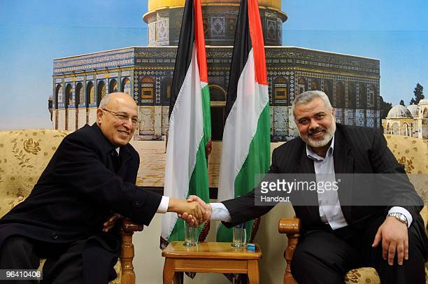 In this handout image supplied by the PPM Hamas leader in Gaza Ismail Haniyeh receives Fatah Central Committee member Nabil Sha'ath on February 4...