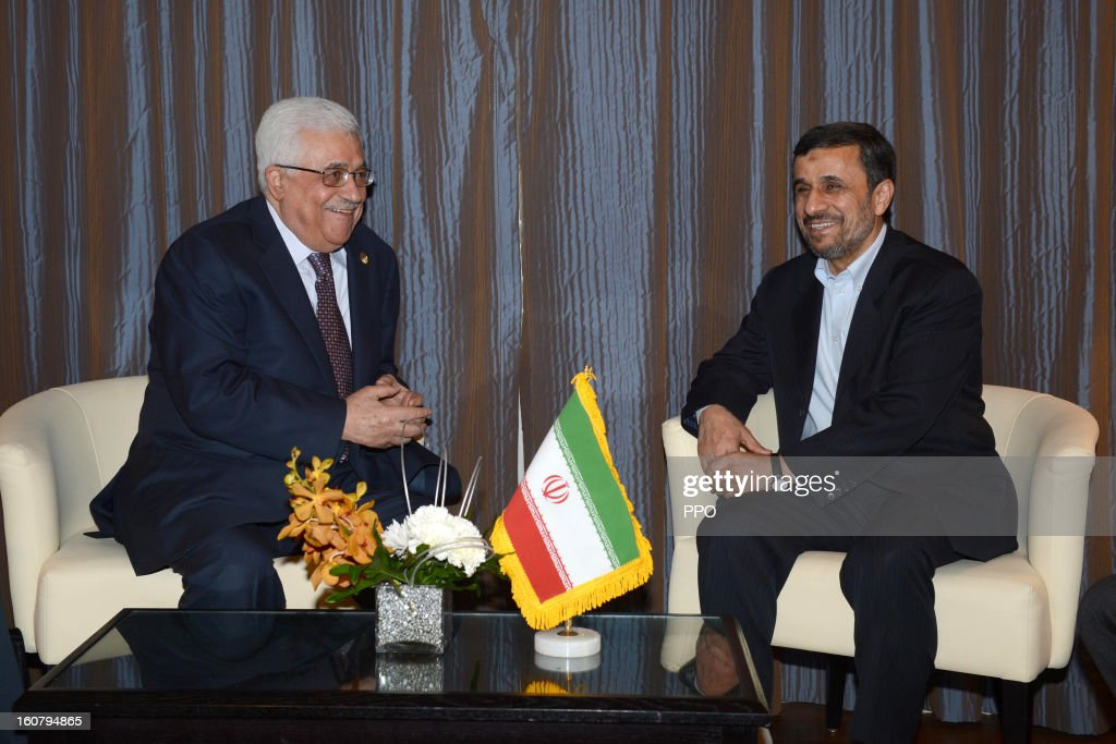 In this handout image supplied by the PPO Palestinian President Mahmoud Abbas attends a meeting with Iranian President Mahmoud Ahmadinejad on...