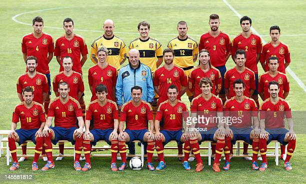 In this handout image supplied by the Royal Spanish Football Federation Spanish head coach Vicente del Bosque poses with his team for a group photo...