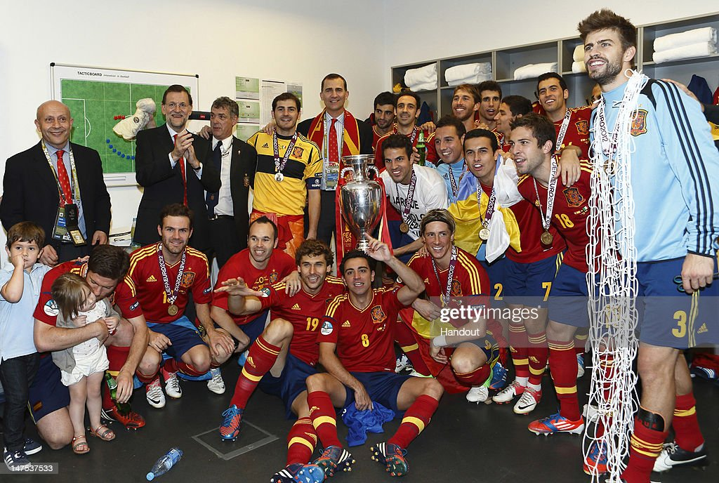 In this handout image supplied by the Royal Spanish Football Federation, Spanish president Mariano Rajoy and Prince Felipe of Spain celebrate with the victorious Spanish team in the dressing room after the UEFA EURO 2012 final match between Spain and Italy at the Olympic Stadium on July 1, 2012 in Kiev, Ukraine.