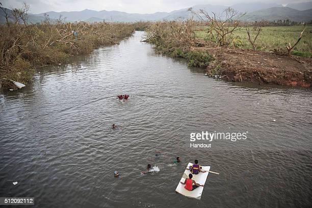 In this handout image supplied by the UNICEF children play on the Rakiraki river near Rakiraki Village on February 24 2016 in Fiji Category 5...