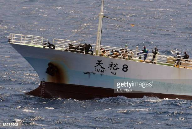 In this handout image supplied by the US Navy Pirates hold the crew of the Chinese fishing vessel FV Tian Yu 8 guard their hostages on November 17...
