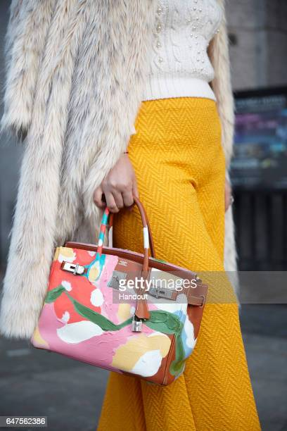 In this handout image supplied by Zhang Jie Wendy Yu bag detail poses outside Emilia Wickstead on day 2 of the London Fashion Week February 2017...
