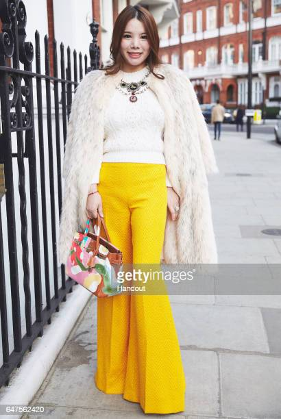 In this handout image supplied by Zhang Jie Wendy Yu poses outside Emilia Wickstead on day 2 of the London Fashion Week February 2017 collections on...
