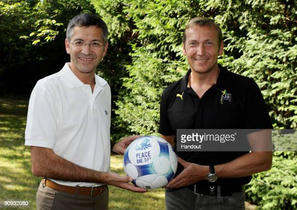 UNSPECIFIED UNDATED In this handout image supplied on September 18 2009 by Peace One Day sportswear rivals adidas CEO Herbert Hainer and Puma...