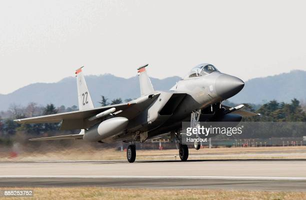 In this handout image taken on December 1 by US Air Force and released on December 4 A US Air Force F15 fighter jet touching down at Gwangju Air Base...
