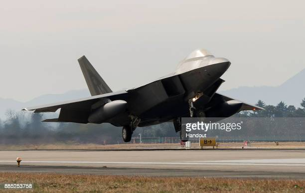 In this handout image taken on December 2 by US Air Force and released on December 4 A US Air Force F22 Raptor fighter jet touching down at Gwangju...