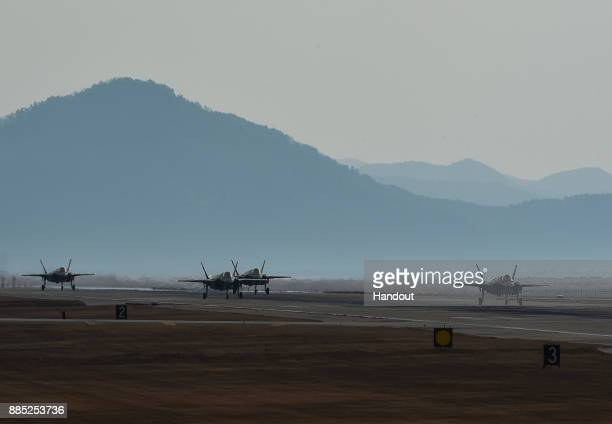 In this handout image taken on December 3 by US Air Force and released on December 4 US Air Force F35A Lightning II fighter jets taxiing at Kunsan...