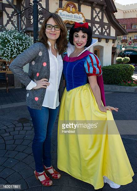In this handout images provided by Disney Parks Tina Fey poses with Snow White in the Germany pavilion at Epcot February 18 2013 in Lake Buena Vista...