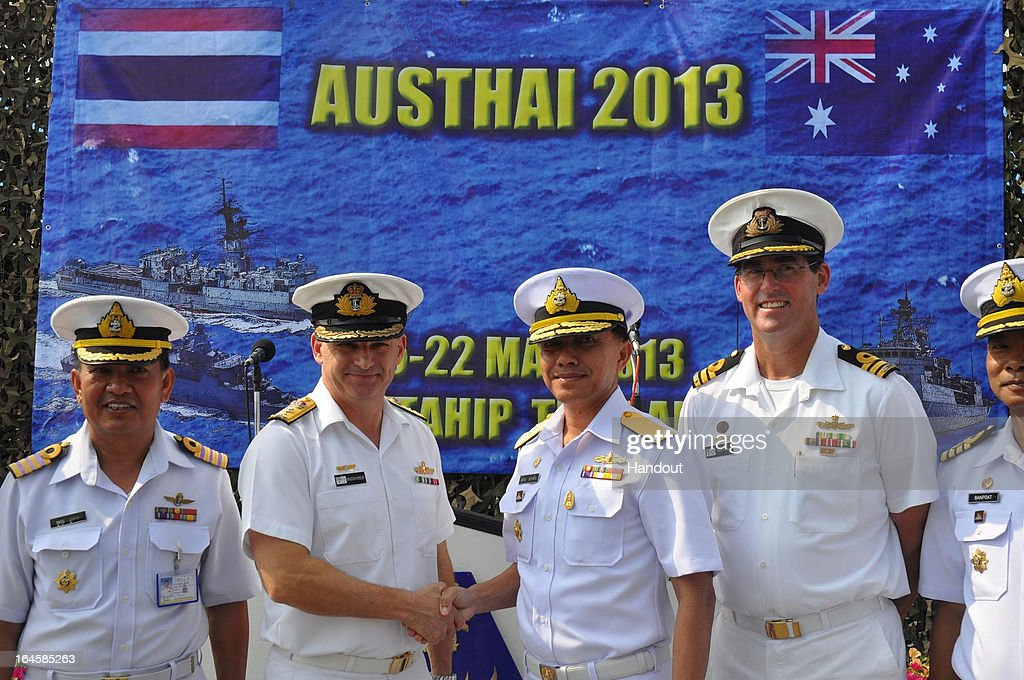 In this handout images provided by the Australian Department of Defence, RADM Somchai Nabangchang , Commanding Officer of Royal Thai Navy Squadron 1 (3rd L) shakes hands with CDRE Braddon Wheeler, RAN Director General Maritime Operations (2nd L) during the Opening Ceremony of Exercise AUSTHAI on March 19, 2013 in Sattahip, Thailand. HMAS Parramatta travelled to Thailand in March 2013 to conduct Exercise AUSTHAI 2013 with the Royal Thai Navy HTM Ships Rattanakosin and Phutthayotfa Chulalok. The three ships were joined by two maritime patrol aircraft: an AP3-C Orion from the Royal Australian Air Force, and a Royal Thai Navy Dornier 228. The primary aim ofExercise AUSTHAI 13, held in the Gulf of Thailand, was to practice maritime warfare skills and to strengthen naval interoperability, including through the application of maritime patrol aircraft.