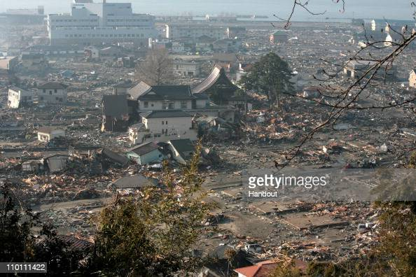 In this handout images provided by the International Federation of Red Cross Japan A general view is seen of what is left of the city after a tsunami...