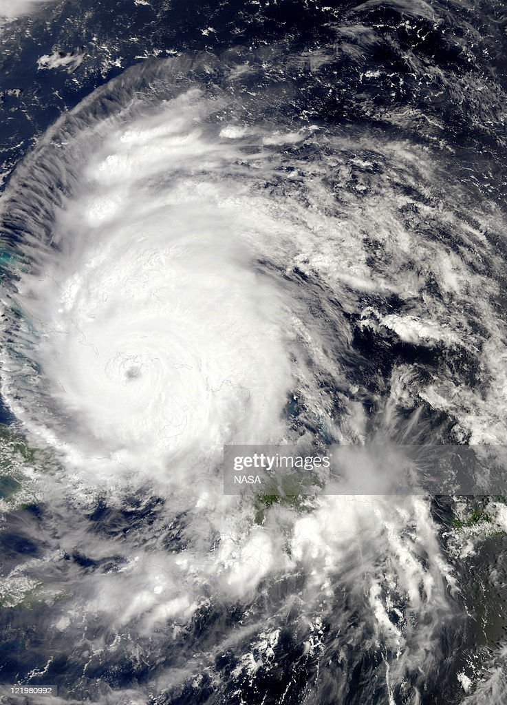 In this handout MODIS satellite image provided by the NASA Goddard Space Flight Center, Hurricane Irene churns over the Bahamas on August 24, 2011 in the Caribbean Sea. Irene, now a Category 3 storm with winds of 120 miles per hour, is projected to possibly clip the Outer Banks region of North Carolina before moving up the eastern seaboard of the U.S.